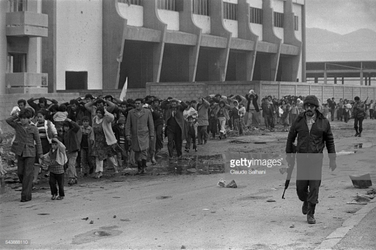 Phalangist Christians invade the neighborhood of Quarantina, one of the Muslim l'une des enclaves of Beirut. Though the inhabitants had fled in the disorder, the Phalangists burned the buildings and shops. (Photo by Claude Salhani/Sygma via Getty Images)